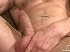 Dean Monroe cums in from the pool to jerk off on the sofa