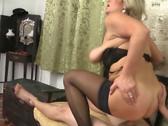 Busty blonde has fun with a cock