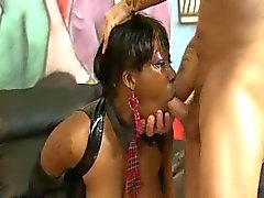 Black slut gobbles thick cocks