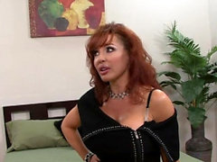 Mature redhead with big tits fucked by a young stud